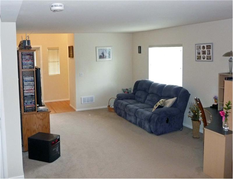 Spacious living area with room for plenty of seating & media.