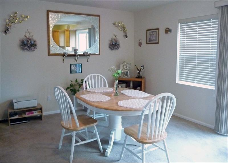 Nice sized dining area near slider to back patio.