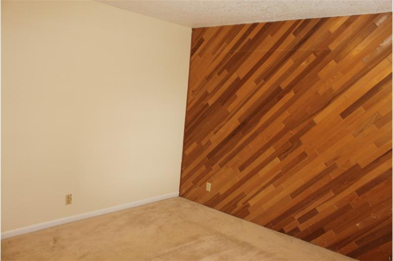 2nd Bedroom with one wall in wood paneling
