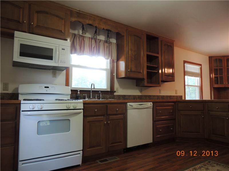 Kitchen - Cherry cabinets, corner cabinets, wood floors, nice large layout.