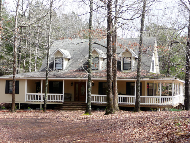 This spacious country home has a wraparound porch on 3 sides.