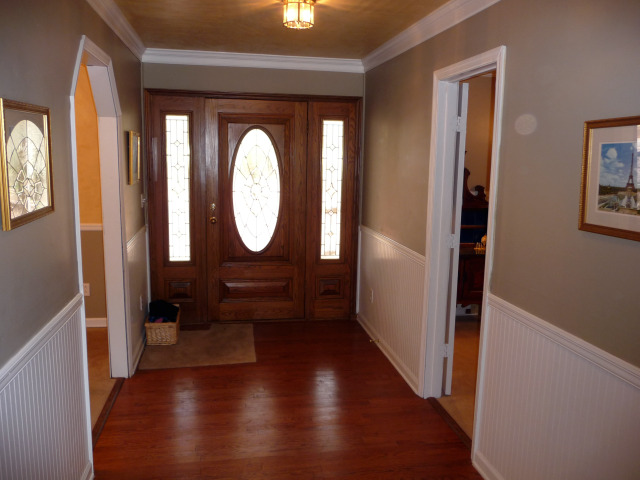 You are greeted by lovely hardwood floors in the wide entry foyer.