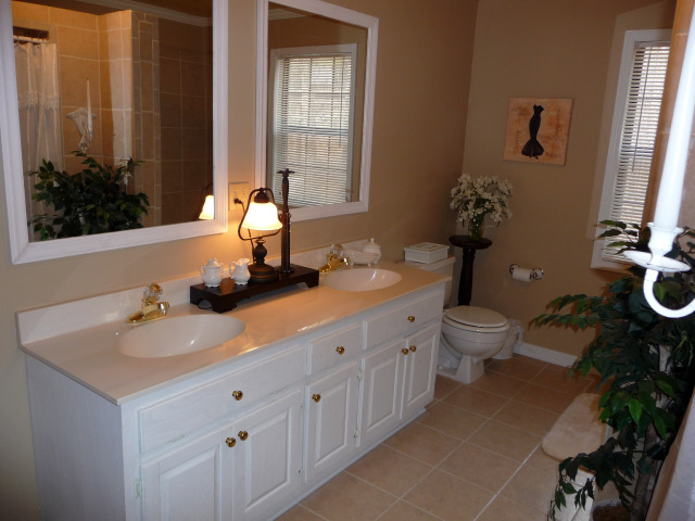 Master bath has been remodeled with ceramic tile, has double vanities.....