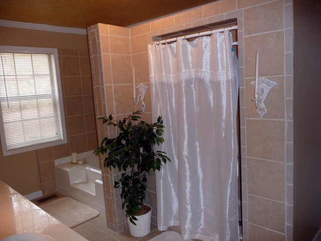 There is also a large separate shower if your prefer.