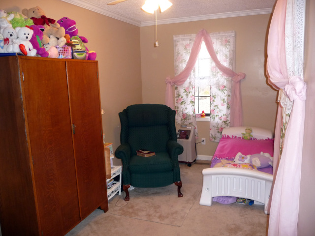 This room is being used as a nursery, could be an office or sewing room.