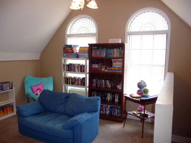 Tall arched windows flood the playroom with lots of light.