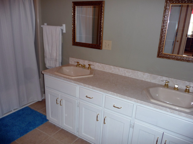 Full bath upstairs has double vanities, tub/shower combo and a window seat.