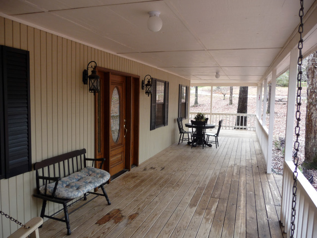 The covered porch is 10 feet wide....