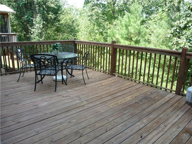 This large deck is great for grilling, entertaining, and looks out to private wooded area in back.