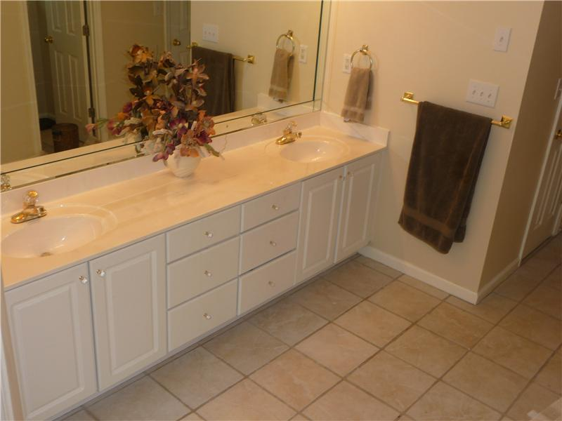 Master bath has tile flooring, double vanities, 2 walk-in closets, jetted garden tub, separate shower and private toilet.