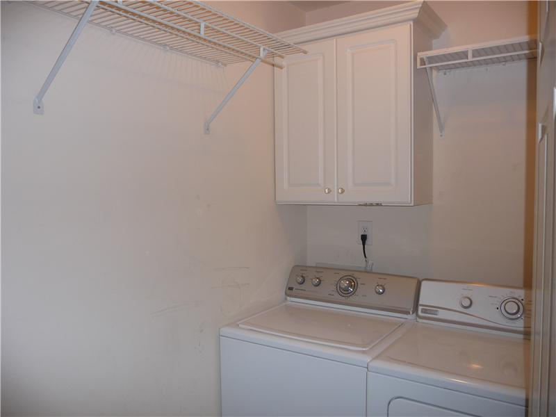 A nice laundry room on level 2....love the convenience of not having to haul laundry up and down stairs!
