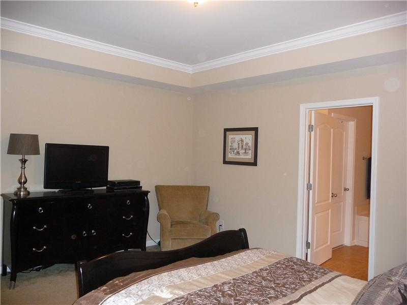 Another view of master bedroom with tray ceiling.