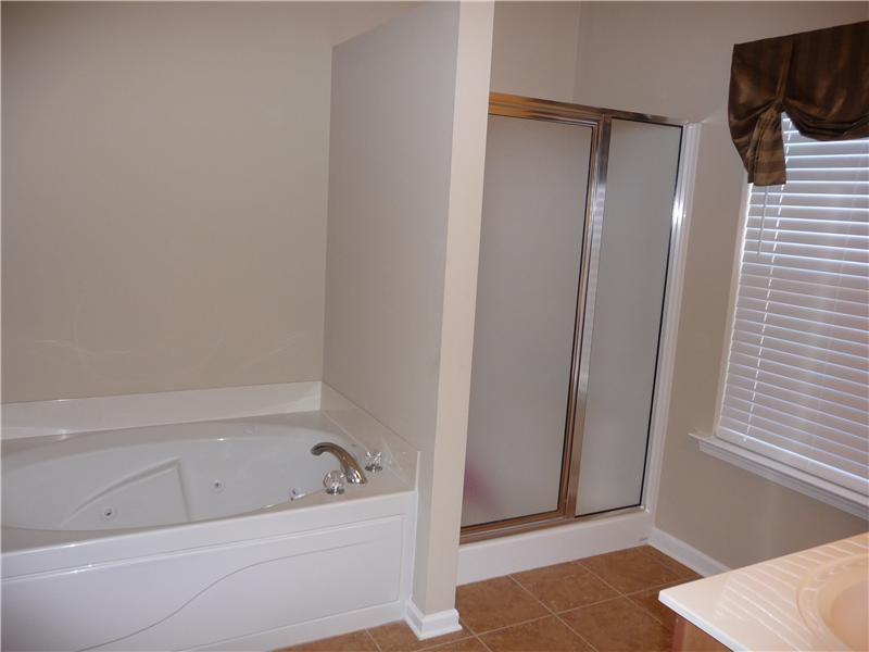 Master bath also has jetted garden tub, separate shower, private toilet and walk-in closet.