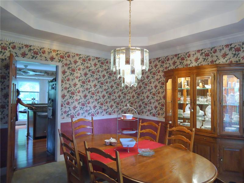 Formal Dining Room with treyed ceiling