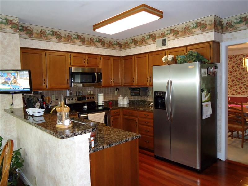 Updated Kitchen includes Granite Counter Tops, Hardwood Floors, Stainless Steel Appliances and Desk