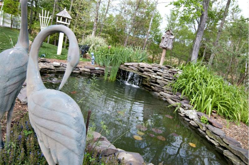 The Koi pond and fountain contribute a relaxing feel to the back of the home.
