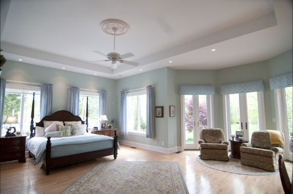 Spacious master suite has Anderson French doors leading onto the terrace and a tray ceiling