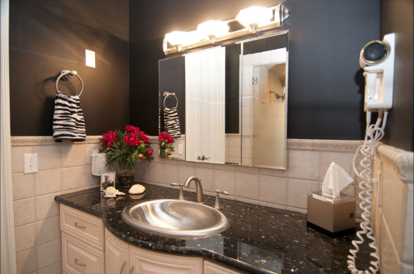 His side with granite vanity and pewter faucet