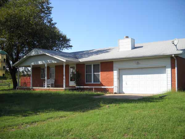 Traditional brick home with attached 2-car garage - nestled on 3 acres m/l