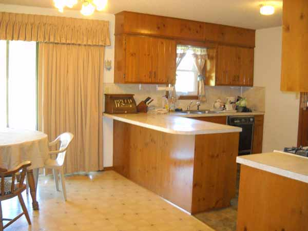 Spacious kitchen with beautiful wood cabinetry, counter seating