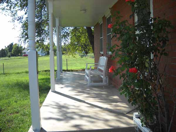 Darling shaded covered porch