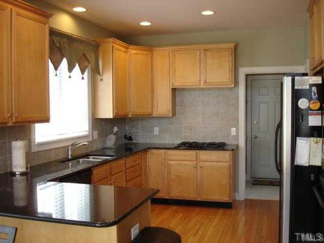 The Kitchen - granite, tile backsplash, stainless appliances.  Great laundry area behind kitchen