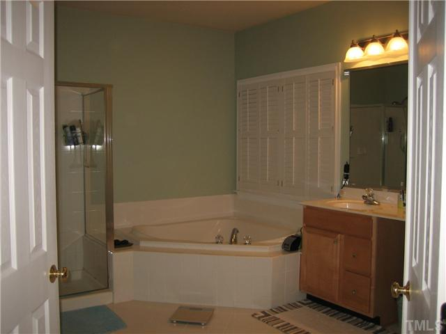 The Master Bath - Jacuzzi tub, shower, plantation shutters