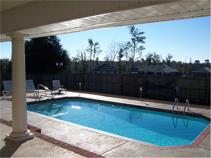 View of Pool from covered rear porch