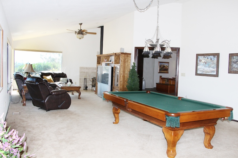Spacious family / game room with wood burning stove and pool table