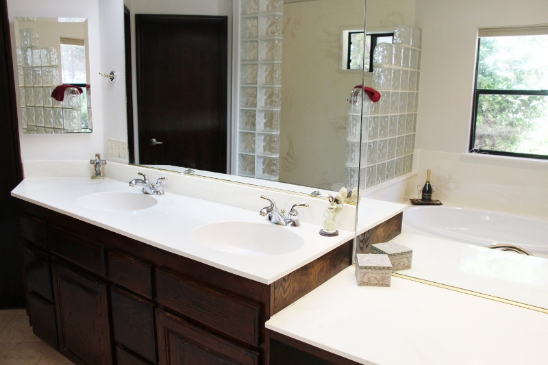Master suite has walk in closet, jetted tub, glass block shower, and patio access
