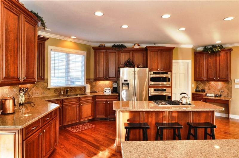 Gourmet kitchen with top-of-the-line stainless steel appliances and double oven