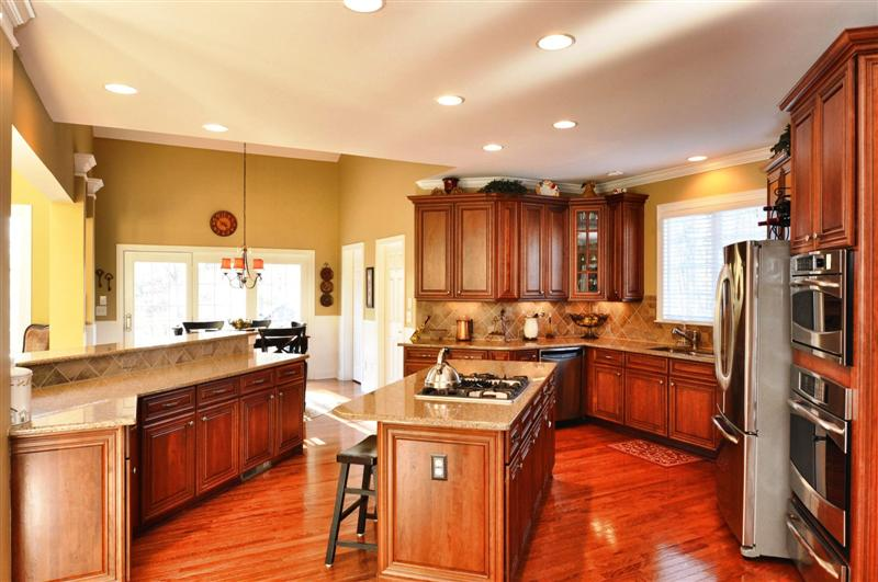 Granite countertops, tile backsplash, 42inch cherry cabinets and butlers pantry