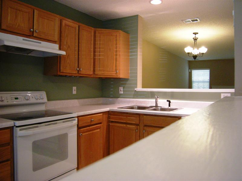 Kitchen has plenty of counter space, dual stainless steel sinks and beautiful wood cabinetry