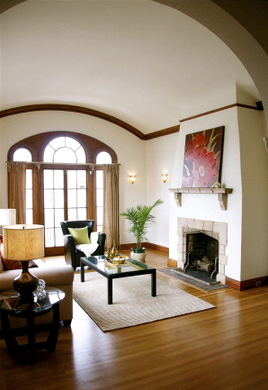Grand living room with high arched ceilings.