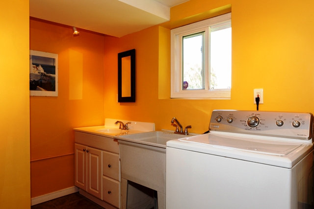 laundry room/powder room in lower level